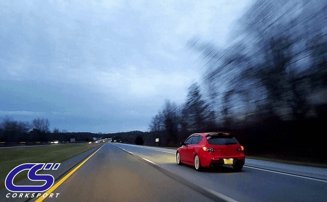 Mazda driving down a road.