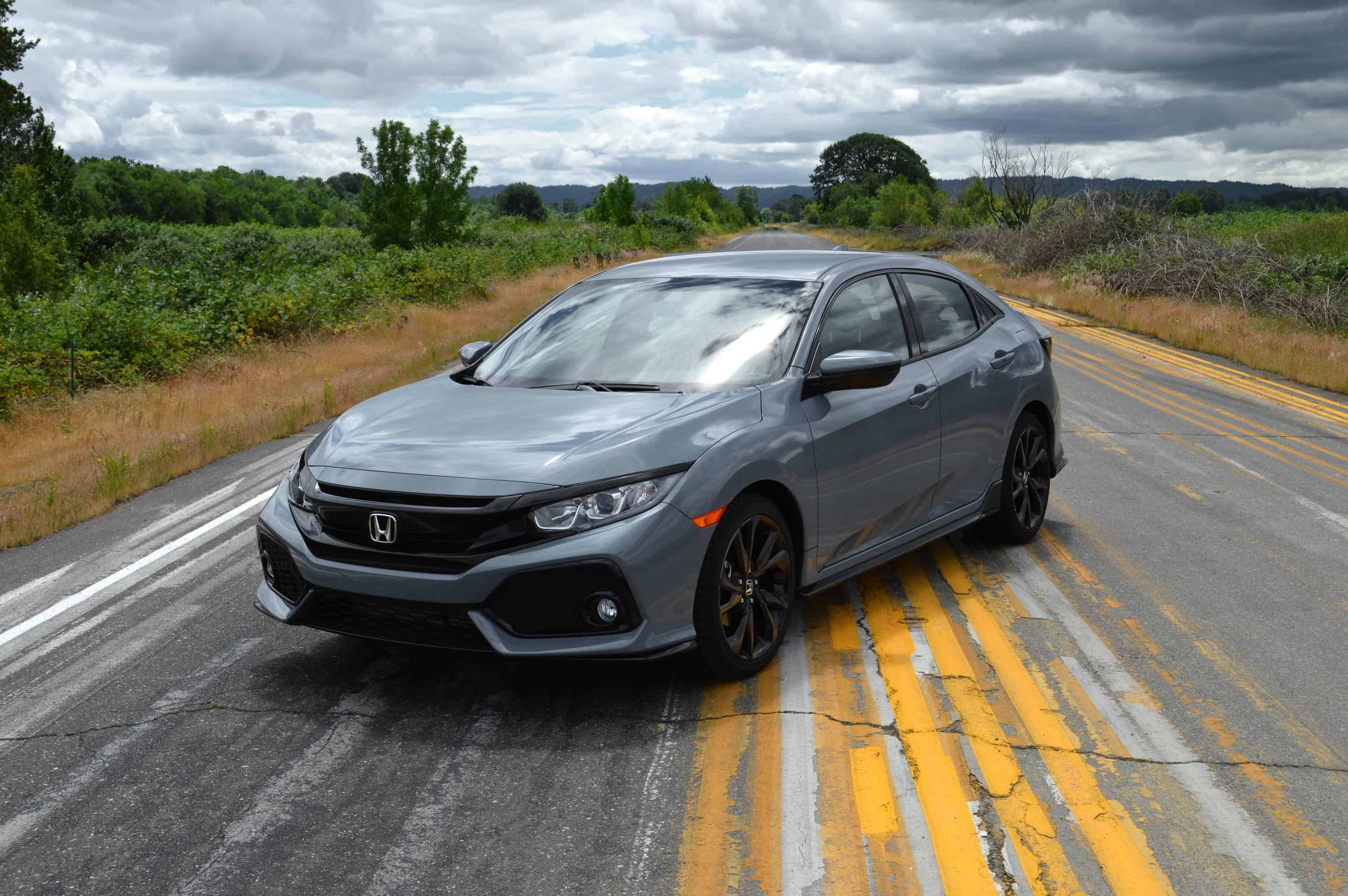 The Hard Lines Ounced Fenders And Smooth Roofline From Hood To End Of Hatch Tell You That Civic Hatchback Is Here Party But Then There S