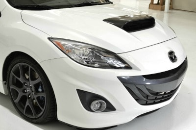 CorkSport's Mazdaspeed3 carbon hood scoop installed.