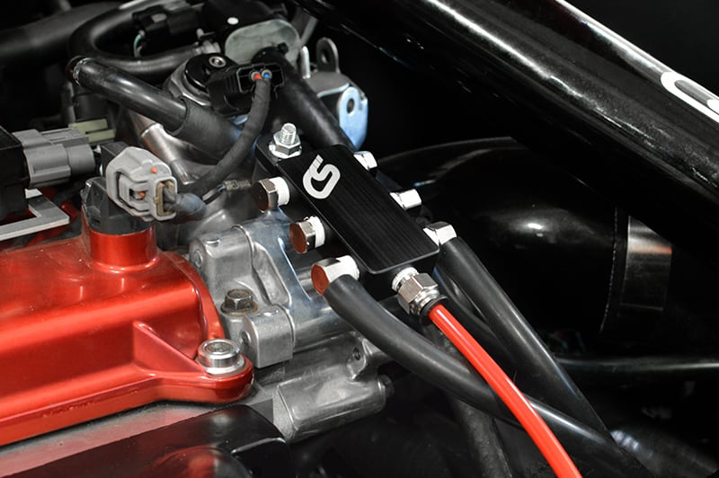 The Mazdaspeed 3 vacuum block helps clean up your engine bay