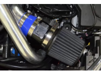 """A close up view of the 3.5"""" intake system in the engine bay of a 2010-2013 Mazdaspeed 3."""