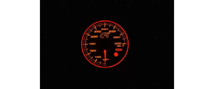 Orange face Mazdaspeed oil temperature gauge.